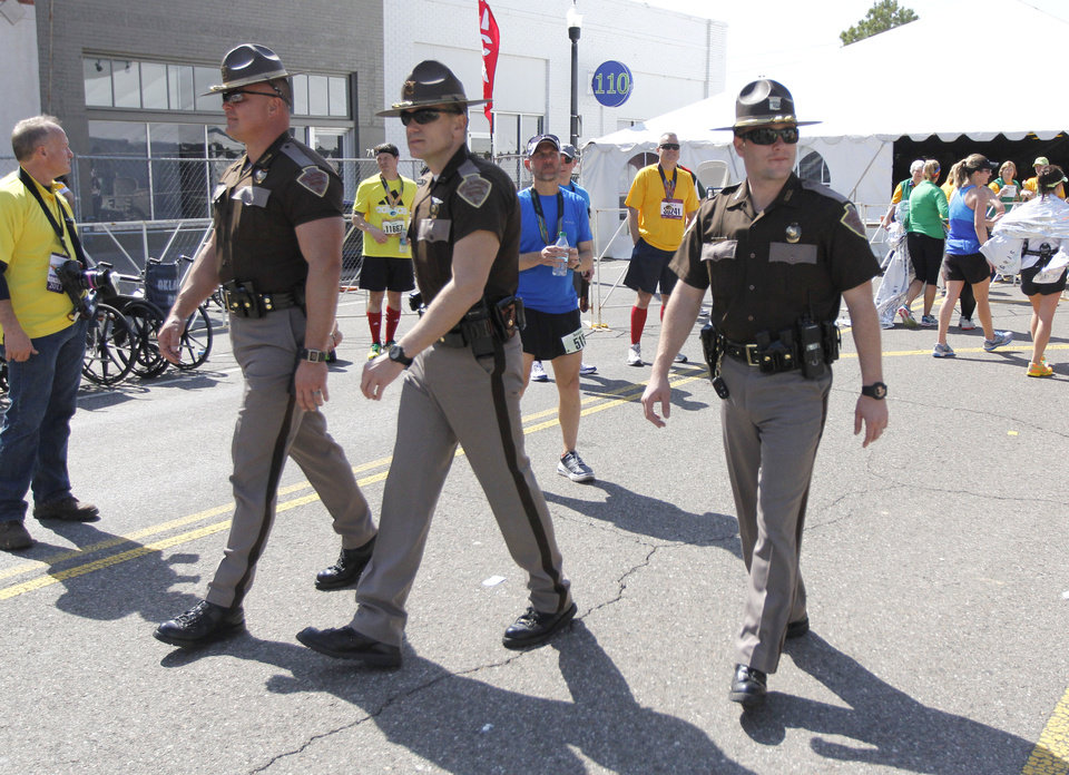 Photo - Oklahoma Highway Patrol troopers provide part of the security for the Oklahoma City Memorial Marathon in Oklahoma City, Sunday, April 28, 2013,  By Paul Hellstern, The Oklahoman