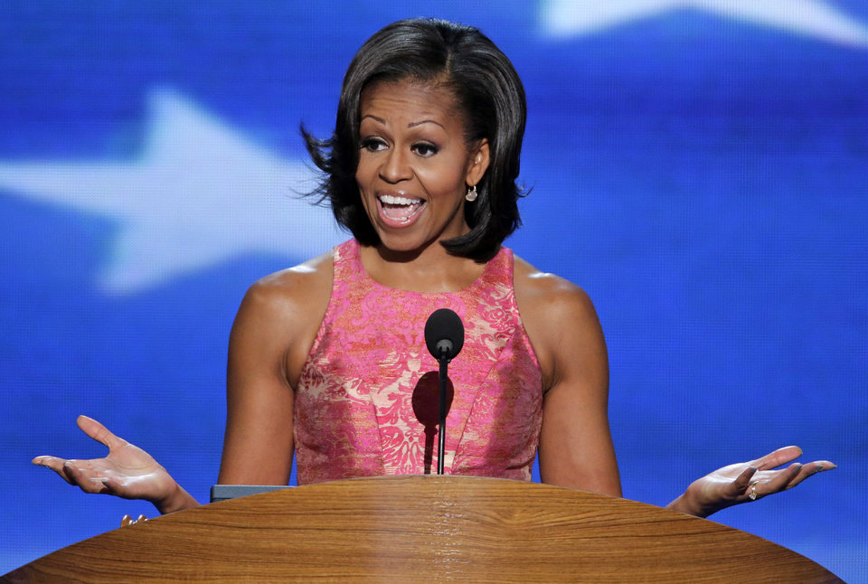 Photo - First Lady Michelle Obama addresses the Democratic National Convention in Charlotte, N.C., on Tuesday, Sept. 4, 2012. (AP Photo/J. Scott Applewhite)  ORG XMIT: DNC191