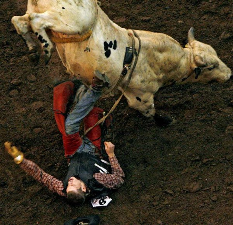Photo - Brett Zabokrtsky gets bucked off a bull during a bullriding event at the Oklahoma State Fair in Oklahoma City.  JOHN CLANTON - THE OKLAHOMAN