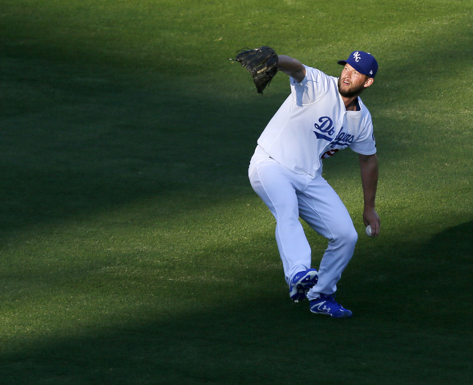 Photo - Clayton Kershaw throws the ball as he warms up before a minor league baseball game between the San Antonio Missions and the Oklahoma City Dodgers at the Chickasaw Bricktown Ballpark in Oklahoma City, Thursday, April 4, 2019. Kershaw pitched four and a third innings in the rehab start for Oklahoma City. Photo by Nate Billings, The Oklahoman