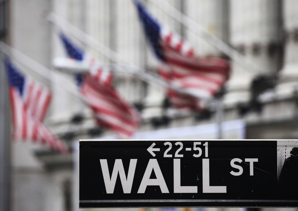 Photo - FILE - This April 22, 2010, file photo, shows a Wall Street sign in front of the New York Stock Exchange. U.S. stocks slumped Thursday, July 31, 2014, as investors reacted to disappointing corporate earnings reports and assessed the implications of the approaching end to economic stimulus from the Federal Reserve. (AP Photo/Mark Lennihan, File)