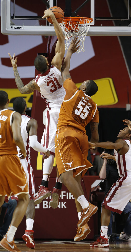 Photo - Oklahoma Sooner D.J. Bennett (31) rebounds on a shot by Texas Longhorn's Cameron Ridley (55) as the University of Oklahoma Sooners (OU) men play the Texas Longhorns (TU) in NCAA, college basketball at The Lloyd Noble Center on Saturday, March 1, 2014  in Norman, Okla. Photo by Steve Sisney, The Oklahoman