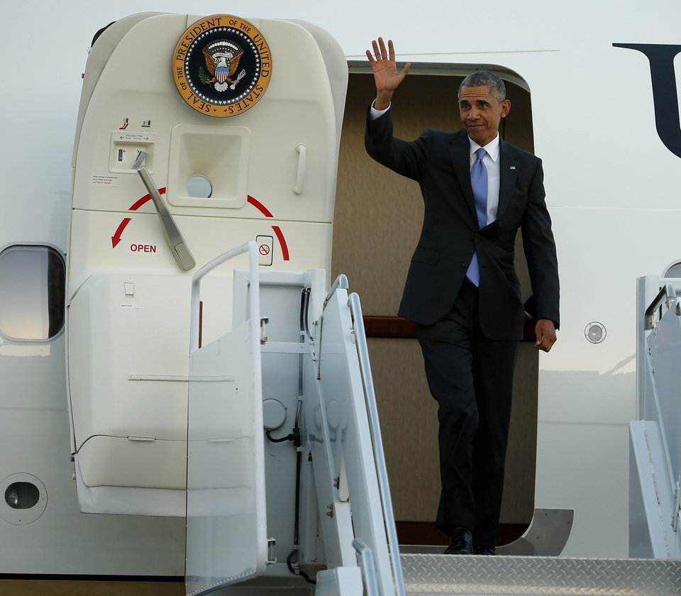 Photo - President Barack Obama exits Air Force One at Tinker Air Force Base, Wednesday, July 15, 2015. President Barack Obama will visit the Federal Correctional Institution El Reno, where he will meet with Oklahoma law enforcement officials and inmates and conduct an interview for a documentary scheduled to air in the fall. Photo by Bryan Terry, The Oklahoman