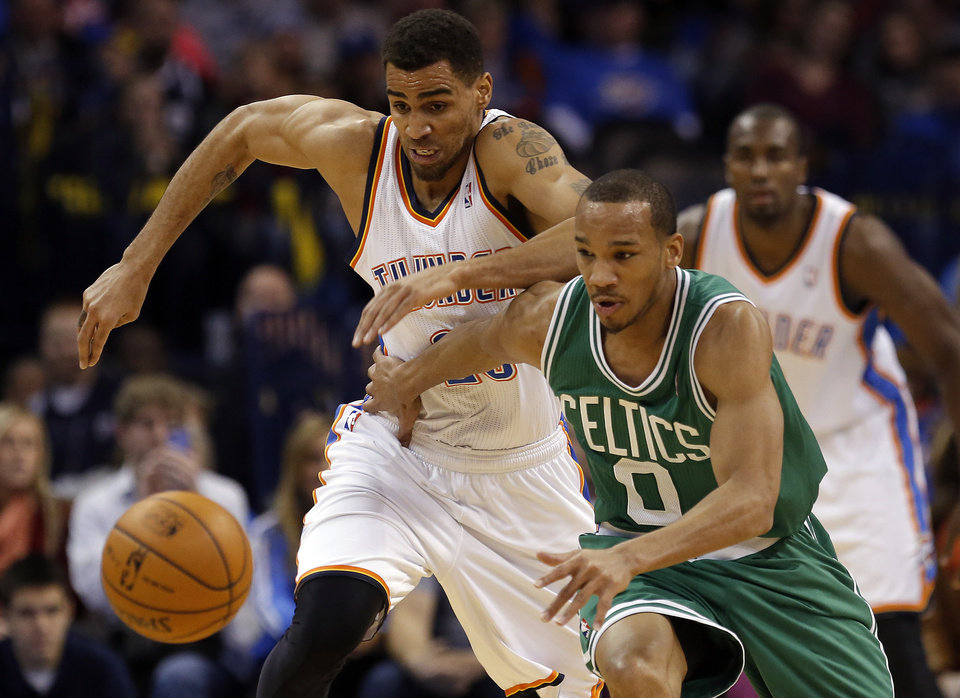 Photo - Oklahoma City's Thabo Sefolosha (25) and Boston's Avery Bradley (0) chase down a loose ball during the NBA game between the Oklahoma City Thunder and the Boston Celtics at the Chesapeake Energy Arena., Sunday, Jan. 5, 2014. Photo by Sarah Phipps, The Oklahoman