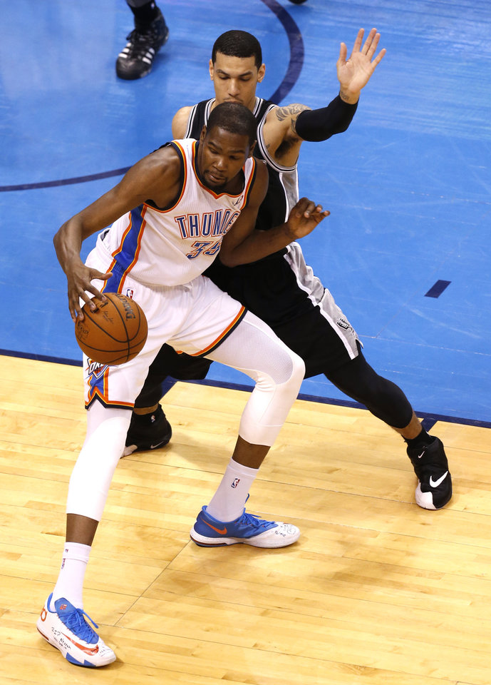 Photo - Oklahoma City's Kevin Durant (35) looks to get around San Antonio's Danny Green (4) during Game 6 of the Western Conference Finals in the NBA playoffs between the Oklahoma City Thunder and the San Antonio Spurs at Chesapeake Energy Arena in Oklahoma City, Saturday, May 31, 2014. Photo by Nate Billings, The Oklahoman