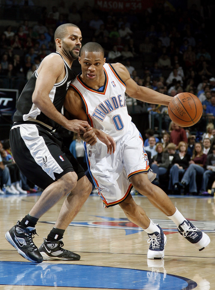 Photo - Oklahoma City's Russell Westbrook (0) drives past San Antonio's Tony Parker (9) during the NBA game between Oklahoma City and San Antonio, Tuesday April 7, 2009, at the Ford Center in  Oklahoma CIty. Photo by Sarah Phipps, The Oklahoma