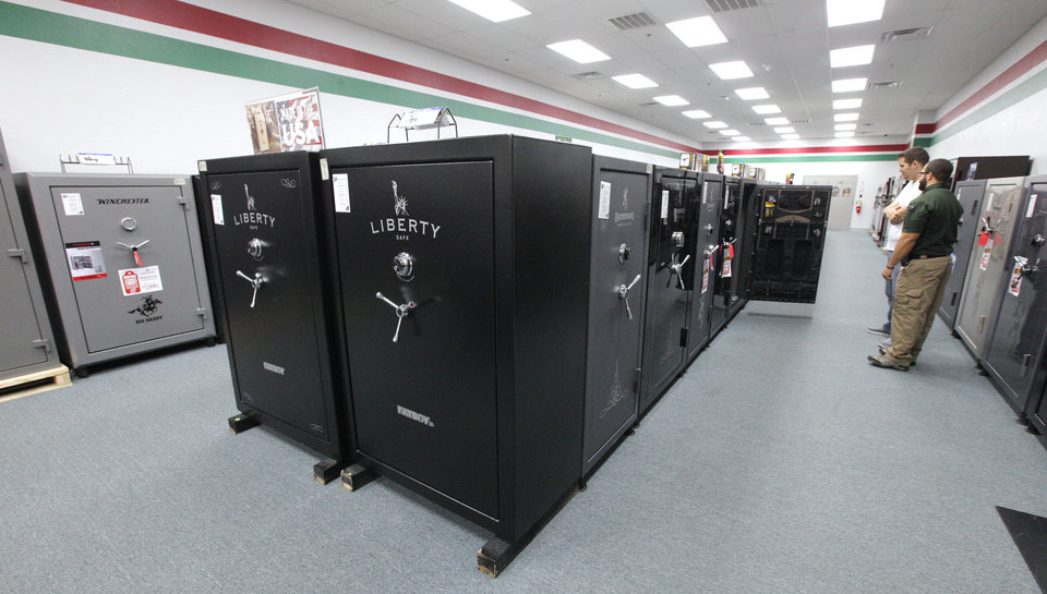 Photo - The gun safe section inside H & H Shooting Sports, 400 S Vermont, in Oklahoma City Wednesday, June 25, 2014.  H & H has the state's largest showroom of gun safes and carries five brands. Photo by Paul B. Southerland, The Oklahoman