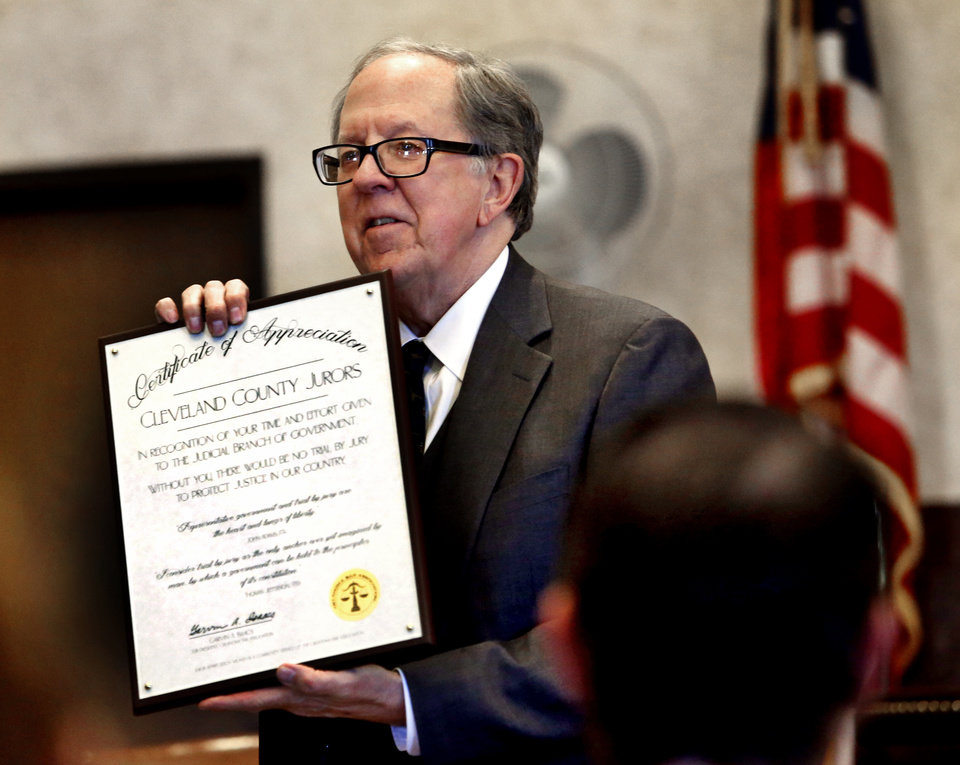 Photo -  Oklahoma Bar Association President Garvin Isaacs presents appreciation awards to Norman judges and jurors in a ceremony at the Cleveland County Courthouse. [PHOTO BY STEVE SISNEY, THE OKLAHOMAN]