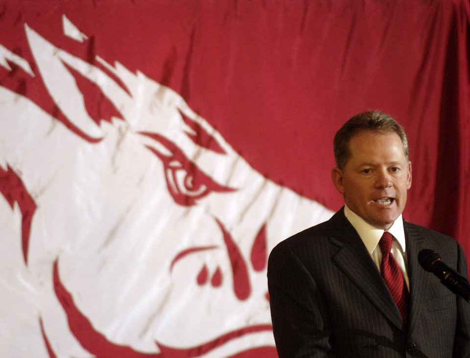 Photo - **CORRECTS SPELLING TO PETRINO FROM PATRINO IN SECOND SENTENCE** Bobby Petrino speaks after being named as head football coach for the University of Arkansas during a news conference Tuesday, Dec. 11, 2007, in Fayetteville, Ark. Petrino resigned as football coach of the Atlanta Falcons and  succeeds Houston Nutt who resigned to become head coach at Mississippi. (AP Photo/Beth Hall) ORG XMIT: ARBH102
