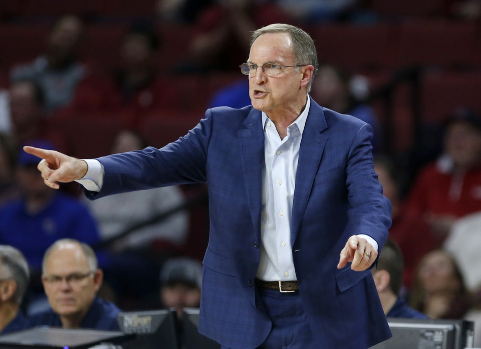 Photo - Oklahoma head coach Lon Kruger reacts to a play during the men's college basketball game between the University of Oklahoma and Kansas at the Lloyd Noble Center in Norman, Okla., Tuesday, March 5, 2019. Photo by Sarah Phipps, The Oklahoman