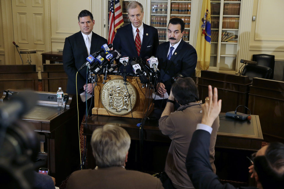 Photo - New Jersey Assemblymen John S. Wisniewski, center, D-Sayreville, N.J., listen to a question with Lou Greenwald, left, D-Vorhees, N.J., and incoming Assembly Speaker Vincent Prieto, D-Secaucus, N.J., Monday, Jan. 13, 2014, in Trenton, N.J. The group announced a new special legislative committee will be tasked with finding out how high up New Jersey Gov. Chris Christie's chain of command a plot went that was linked through emails and text messages to a seemingly deliberate plan to create traffic gridlock in Fort Lee, N.J., after its mayor refused to endorse Christie for re-election. (AP Photo/Mel Evans)