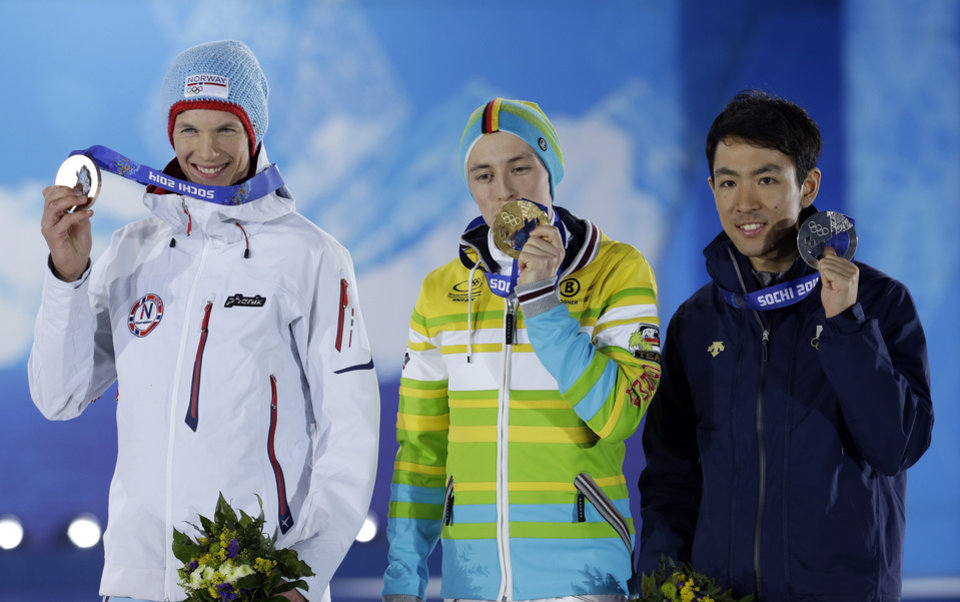 Photo - Medal winners in the men's normal hill nordic combined, from left, Norway's Magnus Krog, bronze, Germany's Eric Frenzel, gold, and Japan's Akito Watabe, silver, pose with their medals at the 2014 Winter Olympics in Sochi, Russia, Thursday, Feb. 13, 2014. (AP Photo/Morry Gash)