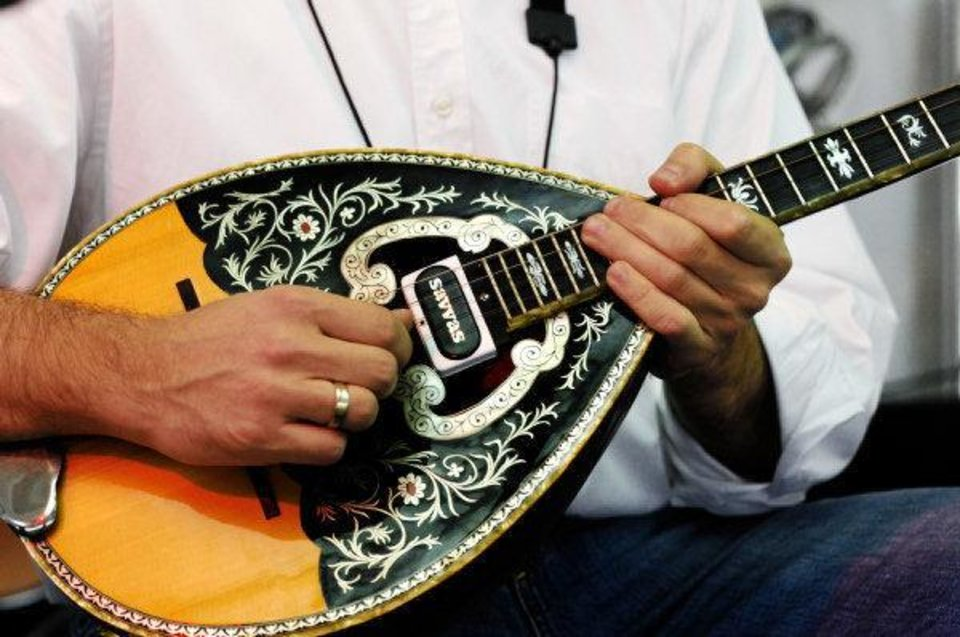 Photo - Yianni plays a bouzouki while  performing Greek music with the band, Tokefi, on Friday, Sep. 9, 2011, during the 27th annual Greek Festival at St. George Greek Orthodox Church in far northwest Oklahoma City.   Tokefi will be entertaining audiences throughout the weekend at the festival.  Photo by Jim Beckel, The Oklahoman  ORG XMIT: KOD
