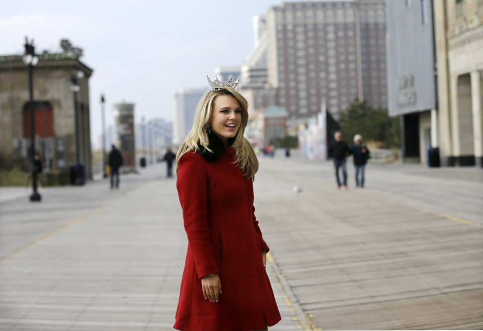 Photo - Miss New Jersey 2012 for the Miss America pageant, Lindsey Petrosh, of Egg Harbor City, N.J., walks along the Boardwalk, Thursday, Feb. 14, 2013, in Atlantic City, after New Jersey Lt. Gov. Kim Guadagno announced that the Miss America pageant is returning to Atlantic City. The pageant returns to Atlantic City in September after spending six years in Las Vegas. (AP Photo/Mel Evans)
