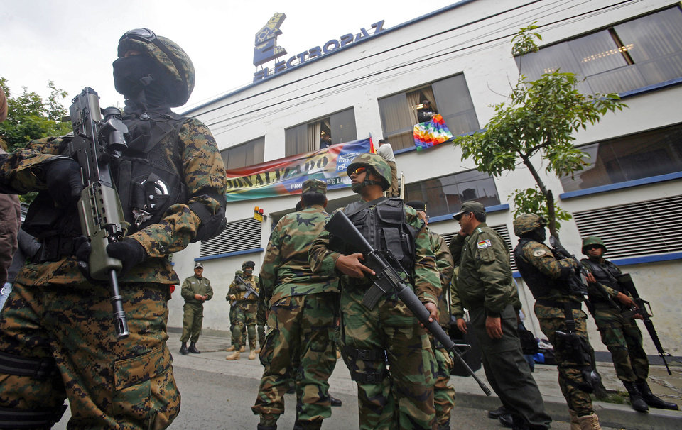 "Marked with signs reading: ""Nationalized,"" soldiers stand guard outside the offices of Electropaz, an electricity distribution subsidiary of the Spanish energy company Iberdrola, in La Paz, Bolivia, Saturday, Dec. 29. 2012. Bolivia's President Evo Morales issued a decree Saturday allowing the takeover of shares in Electropaz and Empresa de Luz y Fuerza de Oruro (Elfeo), which supply energy in the Andean nation. The decree read by Morales also calls for Iberdrola to receive indemnification after an independent firm is hired within 180 days to determine the value of the nationalized shares. (AP Photo)"