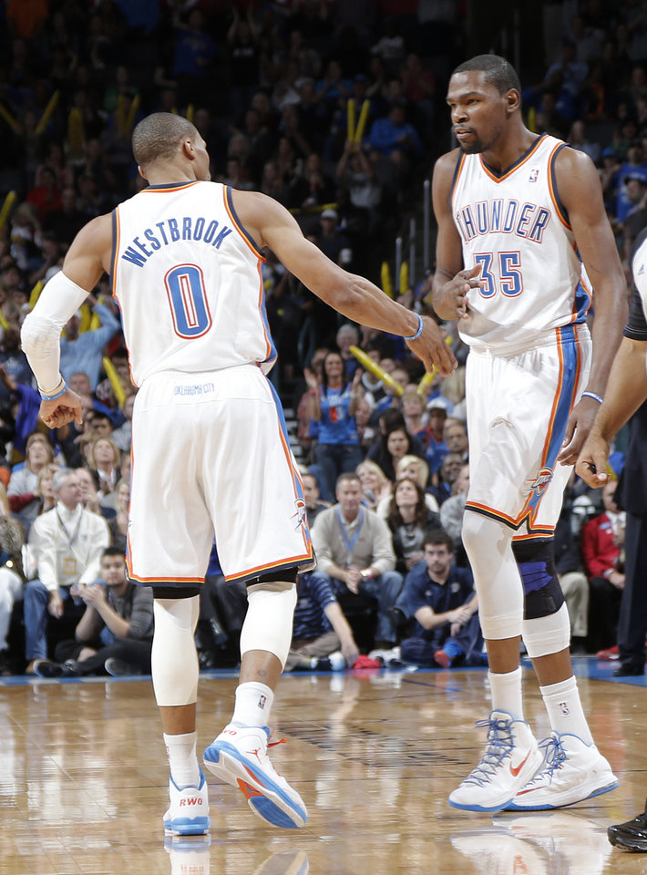 Oklahoma City 's Russell Westbrook (0) and Kevin Durant (35) react after making a three point play during the NBA basketball game between the Houston Rockets and the Oklahoma City Thunder at the Chesapeake Energy Arena on Wednesday, Nov. 28, 2012, in Oklahoma City, Okla.   Photo by Chris Landsberger, The Oklahoman