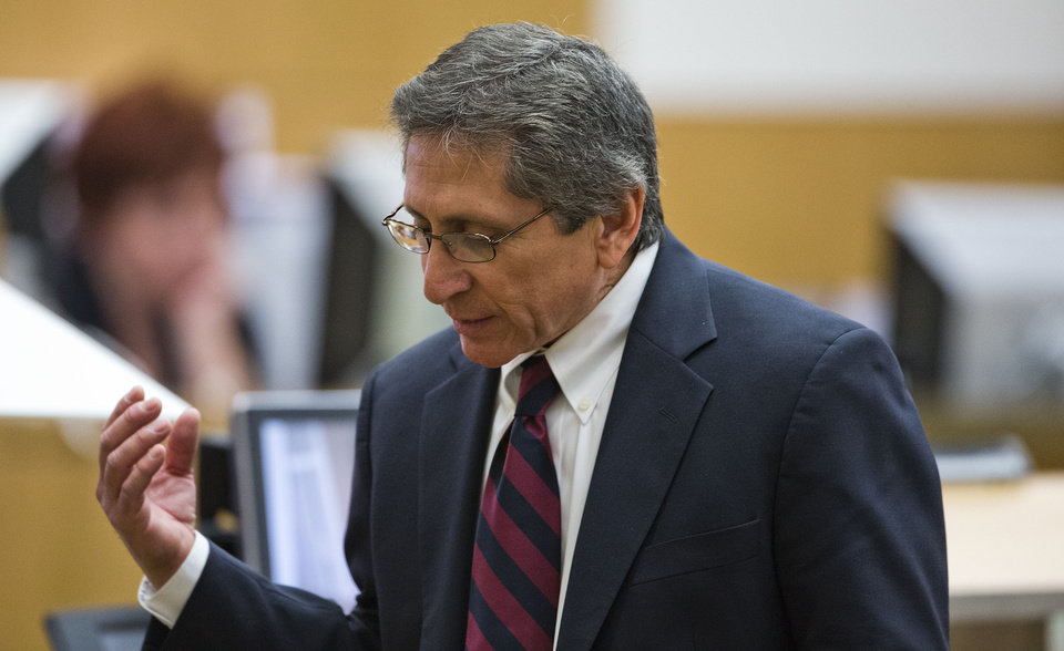 FILE - This feb. 28, 2013 file photo shows prosecutor Juan Martinez asking Jodi Arias about a photo she took of Travis Alexander in the shower, moments before she allegedly shot him, stabbed him and slit his throat, during her murder trial in Phoenix. Known as a bulldog with a one-speed, pedal-to-the-metal approach to prosecuting cases, Martinez no doubt stumped Jodi Arias repeatedly throughout his intense cross-examination in her death penalty trial. (AP Photo/The Arizona Republic, Tom Tingle, Pool, file)