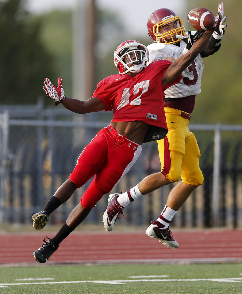 Lawton's Curtez Zachary breaks up a pass intended for Putnam City North's Alex Clark during a football scrimmage  at Putnam City High School in Warr Acres, Okla., Thursday, August 16, 2012. Photo by Bryan Terry, The Oklahoman