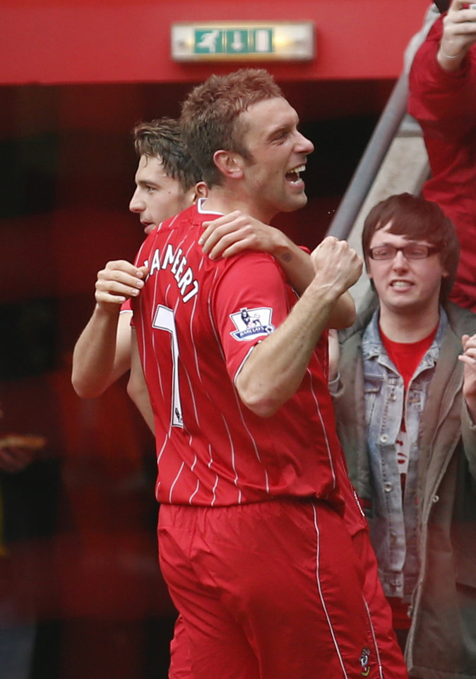 Southampton's Rickie Lambert, center, celebrates his goal against Chelsea with teammate during their English Premier League soccer match at St Mary's stadium, Southampton, England, Saturday, March 30, 2013. (AP Photo/Sang Tan)