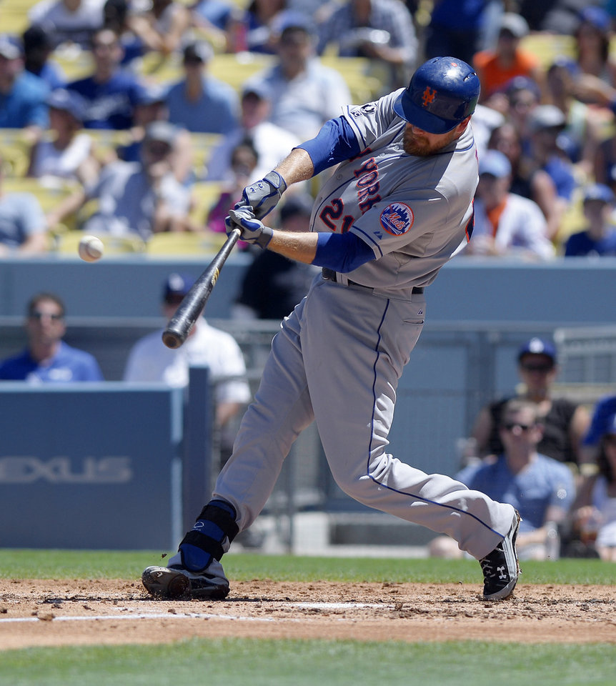 Photo - New York Mets' Lucas Duda hits a three-run home run during the third inning of a baseball game against the Los Angeles Dodgers, Sunday, Aug. 24, 2014, in Los Angeles. (AP Photo/Mark J. Terrill)