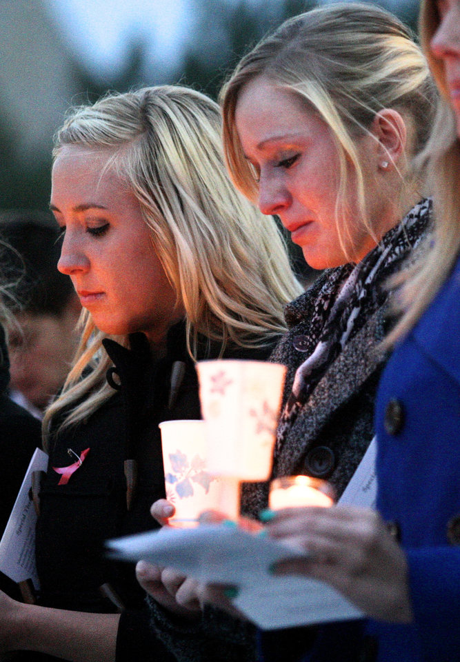 Photo - In this Nov. 7, 2012 photo, Northern Illinois University students Mary Jane Meisenheimer, left, and Lindy Luchowski, both friends of David Bogenberger, participate in a candlelight vigil for Bogenberger outside the Holmes Student Center in DeKalb, Ill. Nearly two dozen Pi Kappa Alpha members at Northern Illinois University have been charged with hazing-related counts after Bogenberger was found dead at their fraternity house following a night of drinking. (AP Photo/Daily Chronicle, Kyle Bursaw) CHICAGO LOCALS OUT; ROCKFORD REGISTER STAR OUT; MANDATORY CREDIT