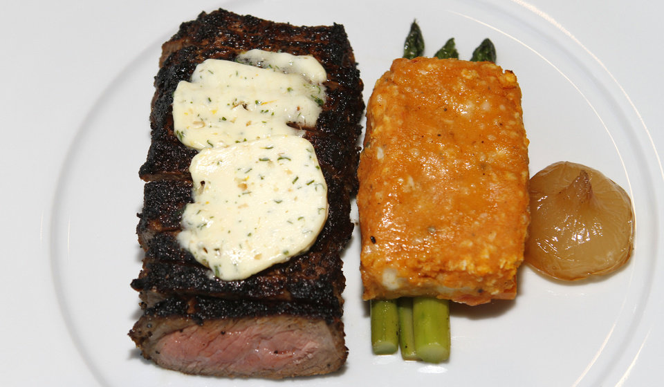 Photo - Vast's menu includes strip steak topped with herb butter, orange-glazed cippolini and asparagus. Photo by Steve Gooch, The Oklahoman  Steve Gooch - The Oklahoman