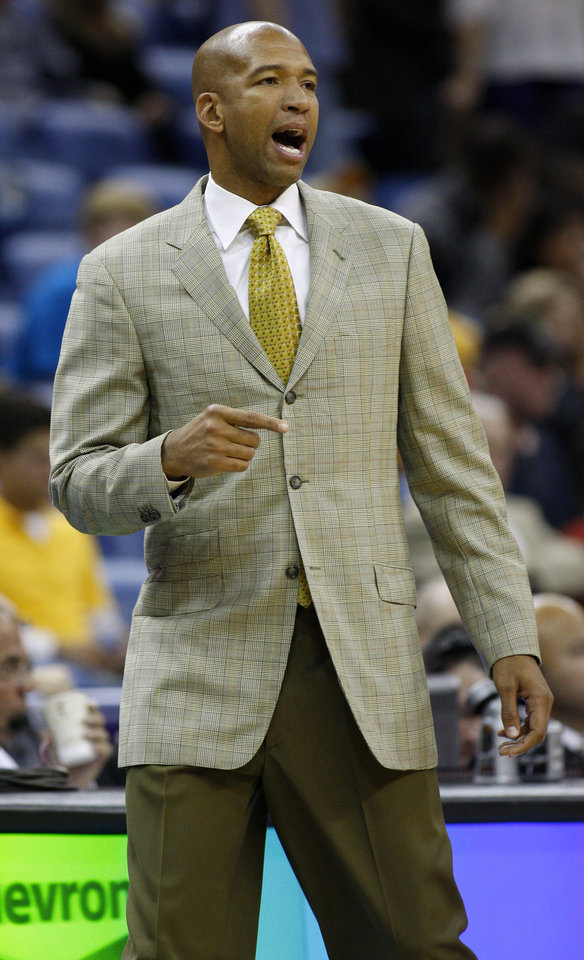 New Orleans Hornets head coach Monty Williams calls to his team during the second half of an NBA basketball game against the Utah Jazz in New Orleans, Friday, Nov. 2, 2012. The Hornets won 88-86. (AP Photo/Jonathan Bachman)