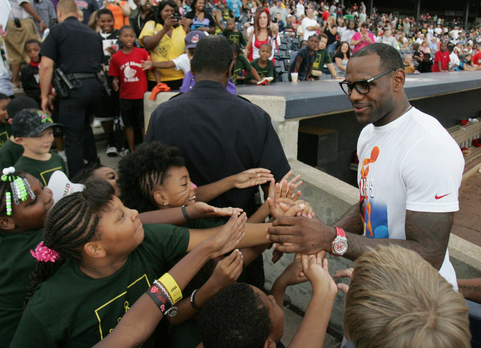 Photo -   ** ADDS MANDATORY CREDIT** NBA star and Akron native LeBron James greets third and fourth graders from the Akron Public Schools as he kicks off the LeBron James Family Foundation's Wheels for Education