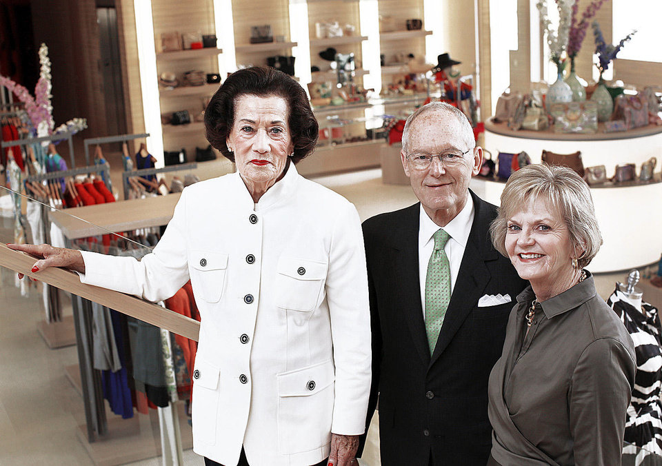 Lolly Sweeney, left, poses with Balliets owners Bob and DeDe Benham. Sweeney, 87, recently celebrated her 67th year with the store. Photo by Jim Beckel, The Oklahoman