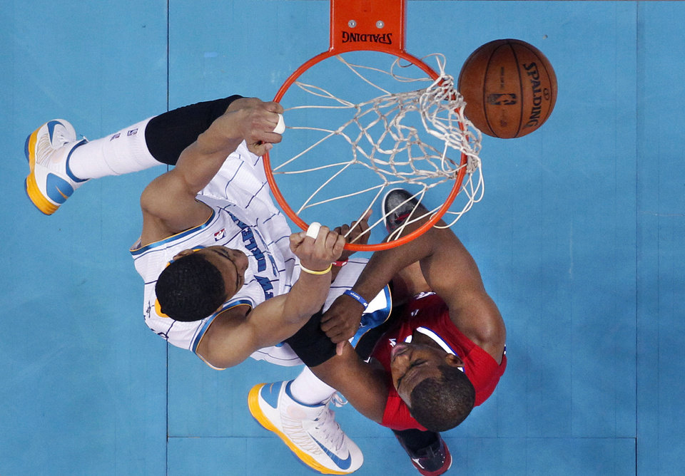 New Orleans Hornets forward Anthony Davis dunks over Los Angeles Clippers guard Chris Paul, right, in the first half of an NBA basketball game in New Orleans, Wednesday, March 27, 2013. (AP Photo/Gerald Herbert)