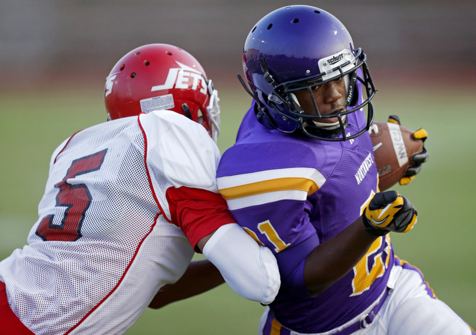 Photo - Northwest Classen's Lorenzo Alexander scores a touchdown past Western Heights' Davonte Drennan during a high school football game at Taft Stadium in Oklahoma City, Thursday, September 20, 2012. Photo by Bryan Terry, The Oklahoman