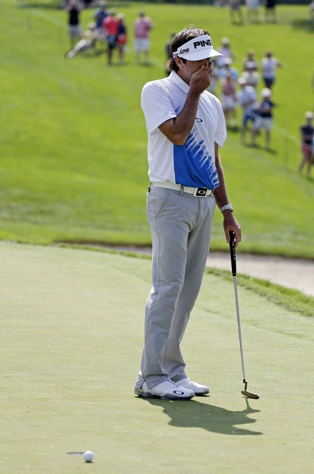 Photo - Bubba Watson reacts to a missed putt on the 13th green during the third round of the Memorial golf tournament Saturday, May 31, 2014, in Dublin, Ohio. (AP Photo/Darron Cummings)