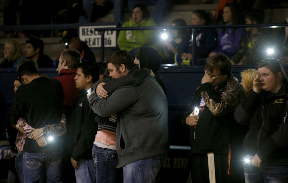 Photo - Students and friends embrace during a vigil Wednesday at Jenks Simmons Fieldhouse in El Reno. The vigil was for two El Reno teenagers, Karson Baker, 15, and Jesse Gorbet, 16, who died after suffering injuries in a car accident, as well as long-time teacher Susan Veekner, who was also died in a separate car accident. Baker and Gorbet were two of three teenagers critically injured in a crash Sunday.  Page 3A    Photo by Bryan Terry, The Oklahoman       BRYAN TERRY - THE OKLAHOMAN