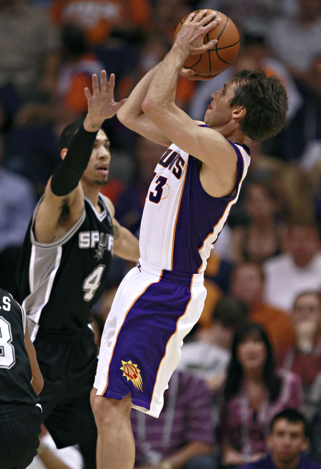 Photo -   Phoenix Suns' Steve Nash, right, shoots over San Antonio Spurs' Danny Green during the first half of an NBA basketball game Wednesday, April 25, 2012, in Phoenix. (AP Photo/Matt York)