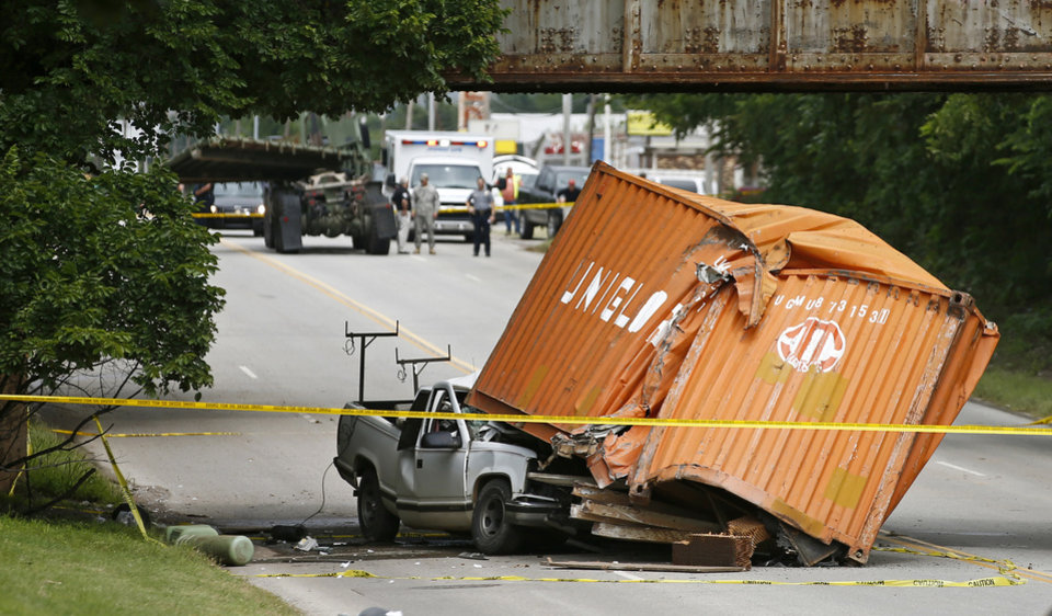 Photo - A person has reportedly been killed inside this pickup after a container fell off the vehicle in the background near NE 23 near Sooner Road at about 2:20 p.m. on Thursday, July 31, 2014. Photo by Bryan Terry, The Oklahoman