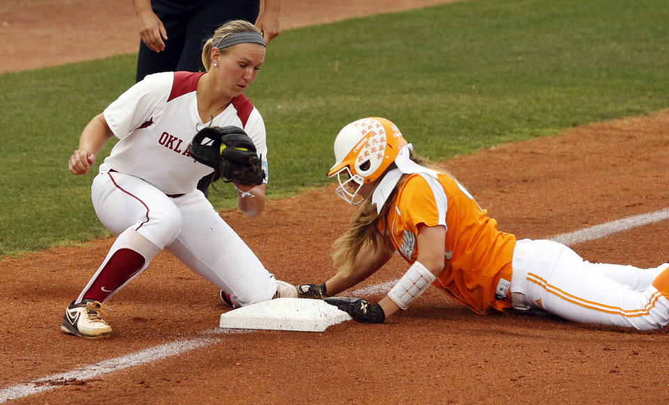 Photo - Tennessee's Madison Shipman is safe at third in front of the tag attempt by Oklahoma's Shelby Pendley as the University of Oklahoma Sooner (OU) softball team plays Tennessee in the first game of the NCAA super regional at Marita Hynes Field on May 23, 2014 in Norman, Okla. Photo by Steve Sisney, The Oklahoman