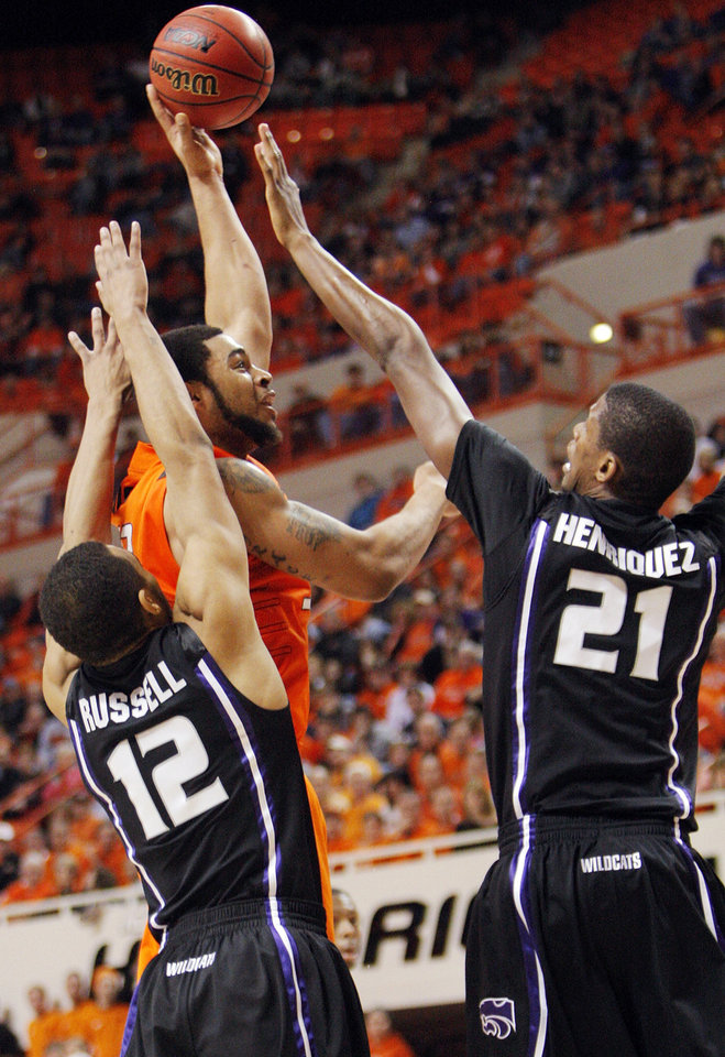 Photo - OSU's Marshall Moses (33) takes a shot between Nick Russell (12) and Jordan Henriquez-Roberts (21) of KSU during the men's college basketball game between Oklahoma State University (OSU) and Kansas State University (KSU) at Gallagher-Iba Arena in Stillwater, Okla., Saturday, January 8, 2011. OSU won, 76-62. Photo by Nate Billings, The Oklahoman
