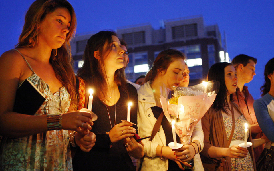 Photo -   Boston University students including Tori Pinheiro, left, of New Bedford, Mass., and Austin Brashears' girlfriend, holds a candlelight vigil on Marsh Plaza at Boston University, Saturday, May 12, 2012, for three students studying in New Zealand who were killed when their minivan crashed during a weekend trip. At least five other students were injured in the accident, including one who was in critical condition. Boston University spokesman Colin Riley said those killed in the accident were Daniela Lekhno, 20, of Manalapan, N.J.; Brashears, 21, of Huntington Beach, Calif.; and Roch Jauberty, 21, whose parents live in Paris. (AP Photo/Bizuayehu Tesfaye)