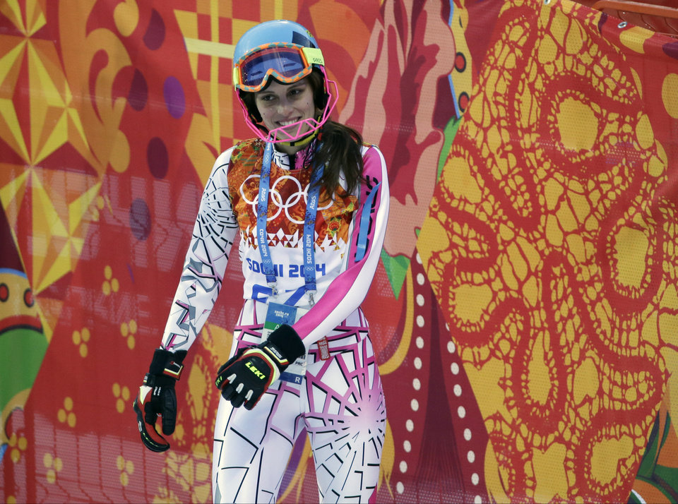 Photo - Lebanon's Jacky Chamoun stands in the finish area after completing the first run of the women's slalom at the Sochi 2014 Winter Olympics, Friday, Feb. 21, 2014, in Krasnaya Polyana, Russia. (AP Photo/Gero Breloer)
