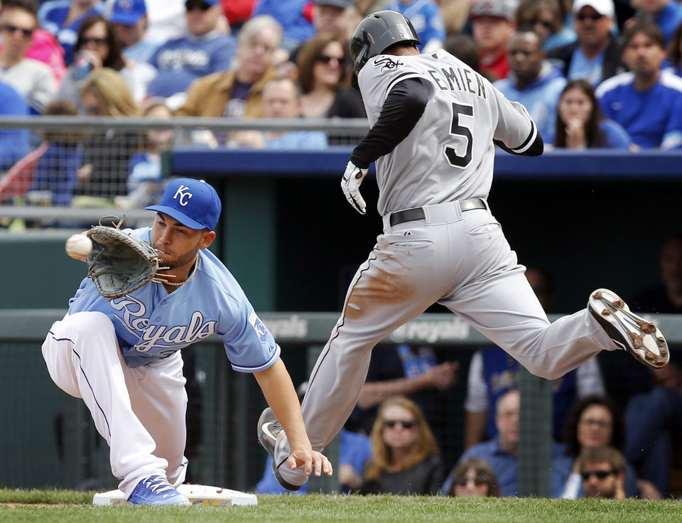 Photo - Kansas City Royals first baseman Eric Hosmer, left, forces out Chicago White Sox' Marcus Semien (5) during the sixth inning of a baseball game at Kauffman Stadium in Kansas City, Mo., Sunday, April 6, 2014. Semien was called safe before review of the play overturned the call. (AP Photo/Orlin Wagner)