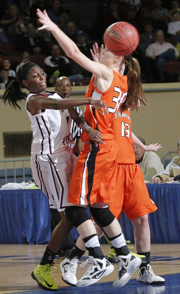 Photo - Northeast's Lanesia Williams (1) passes the ball past Fairview's Sadie Mason (30) during the state high school basketball tournament Class 2A girls semifinal game between Fairview High School and Northeast High School at the State Fair Arena on Friday, March 8, 2013, in Oklahoma City, Okla. Photo by Chris Landsberger, The Oklahoman