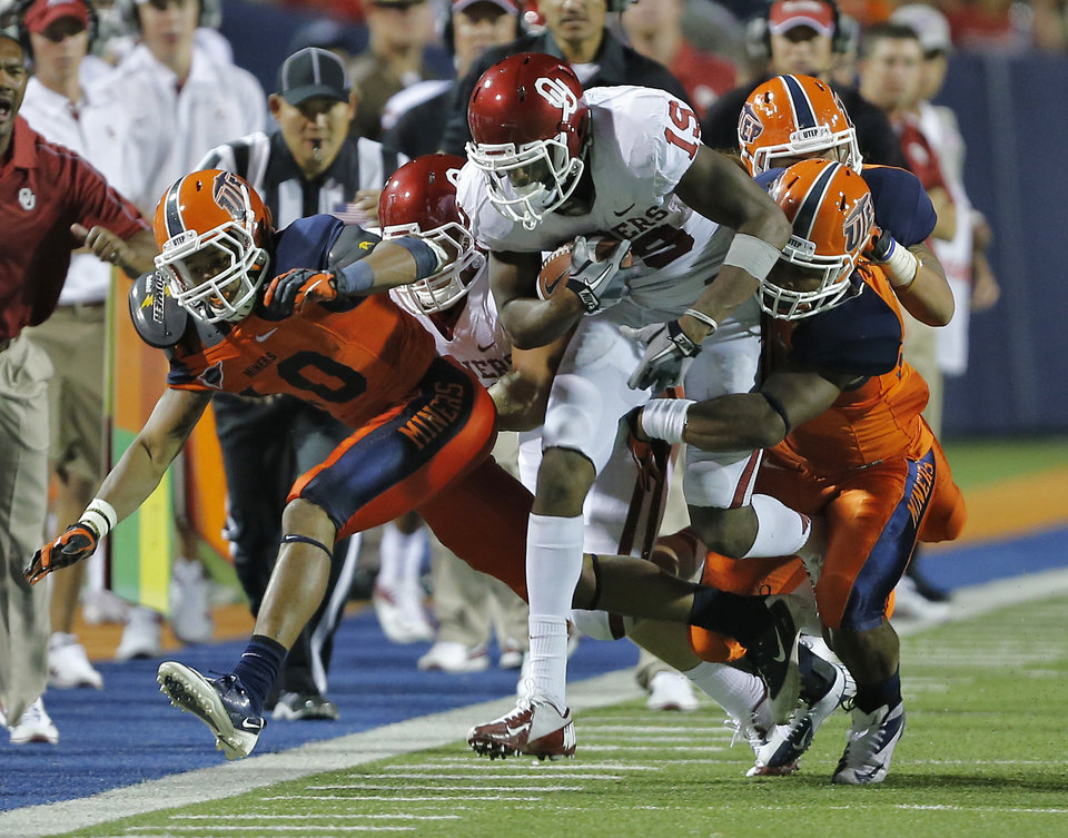 Photo - Oklahoma Sooners wide receiver Justin Brown (19) is brought down by the UTEP defense during the college football game between the University of Oklahoma Sooners (OU) and the University of Texas El Paso Miners (UTEP) at Sun Bowl Stadium on Saturday, Sept. 1, 2012, in El Paso, Tex.  Photo by Chris Landsberger, The Oklahoman