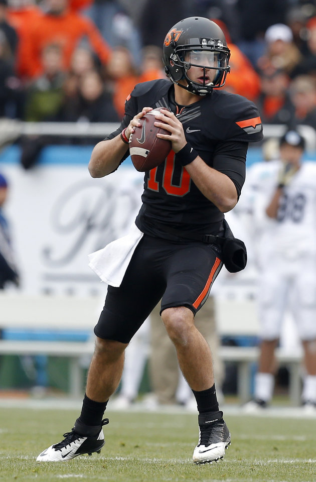 Oklahoma State's Clint Chelf (10) looks to throw a pass during the Heart of Dallas Bowl football game between the Oklahoma State University (OSU) and Purdue University at the Cotton Bowl in Dallas,  Tuesday,Jan. 1, 2013. Photo by Sarah Phipps, The Oklahoman