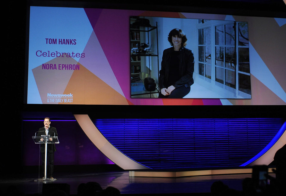 Photo - This image released by Women in the World Conference shows actor Tom Hanks offering a special tribute to the late writer-director Nora Ephron at the Women in the World Conference, Friday, April 5, 2013, in New York. Hanks starred in Ephron's films