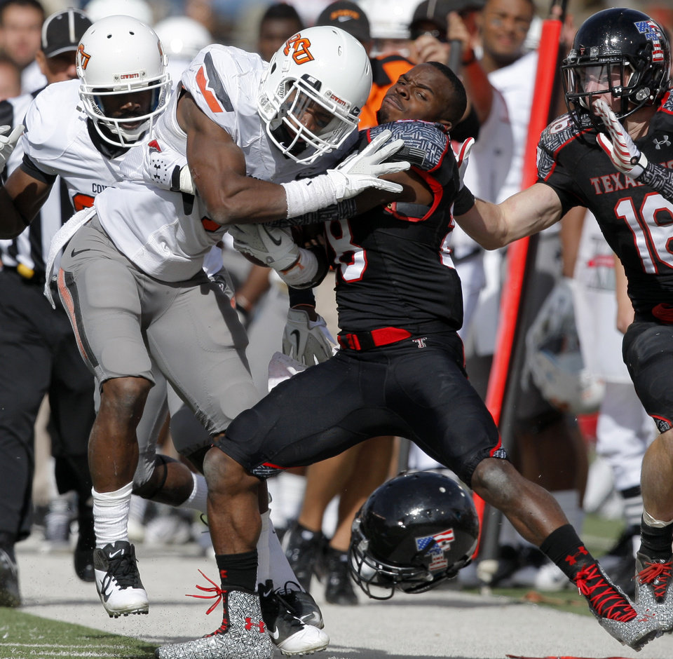 Photo - Texas Tech's Happiness Osunde (28) tries to bring down Oklahoma State's Joseph Randle (1) during a college football game between Texas Tech University (TTU) and Oklahoma State University (OSU) at Jones AT&T Stadium in Lubbock, Texas, Saturday, Nov. 12, 2011.  Photo by Sarah Phipps, The Oklahoman  ORG XMIT: KOD