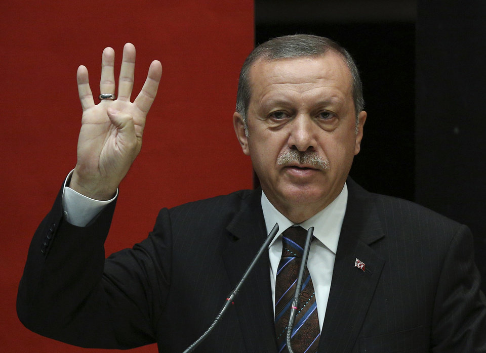 Photo - FILE - This is a Thursday, Aug. 14, 2014 file photo of  Turkish Prime Minister Recep Tayyip Erdogan addresses the members of his ruling Justice and Development Party in Ankara, Turkey.  Turkish ruling party leaders are poised to choose a new party chairman and prime minister to succeed president-elect Recep Tayyip Erdogan. Party officials are convening Thursday Aug. 21, 2014  to pick a leader whom analysts say would be loyal to Erdogan, allowing the man who has dominated Turkish politics for more than a decade to keep a tight rein on government.(AP Photo/ File)