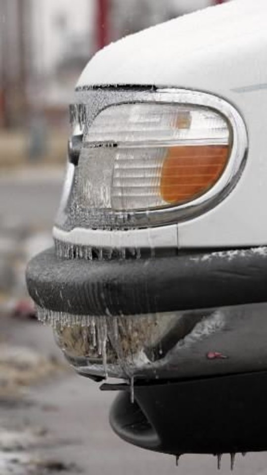 Photo - Icicles form on a vehicle during a winter storm, in Stillwater, Okla., Sunday, December 9, 2007. By Matt Strasen