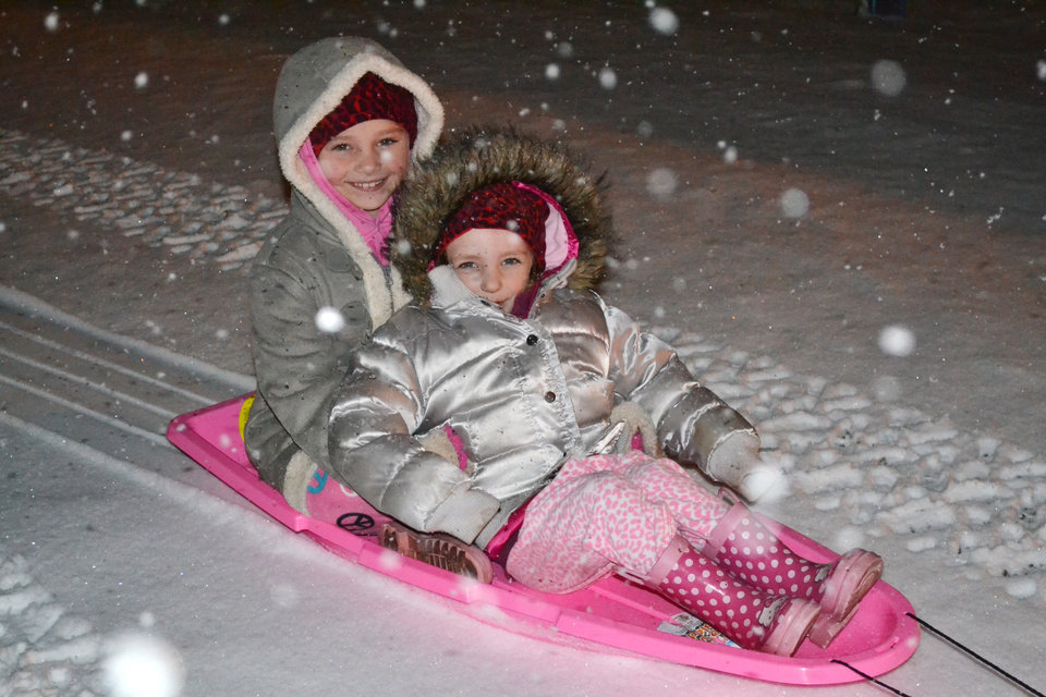 Photo - Girls sledding in Hobart. User submitted by Brett Porter.