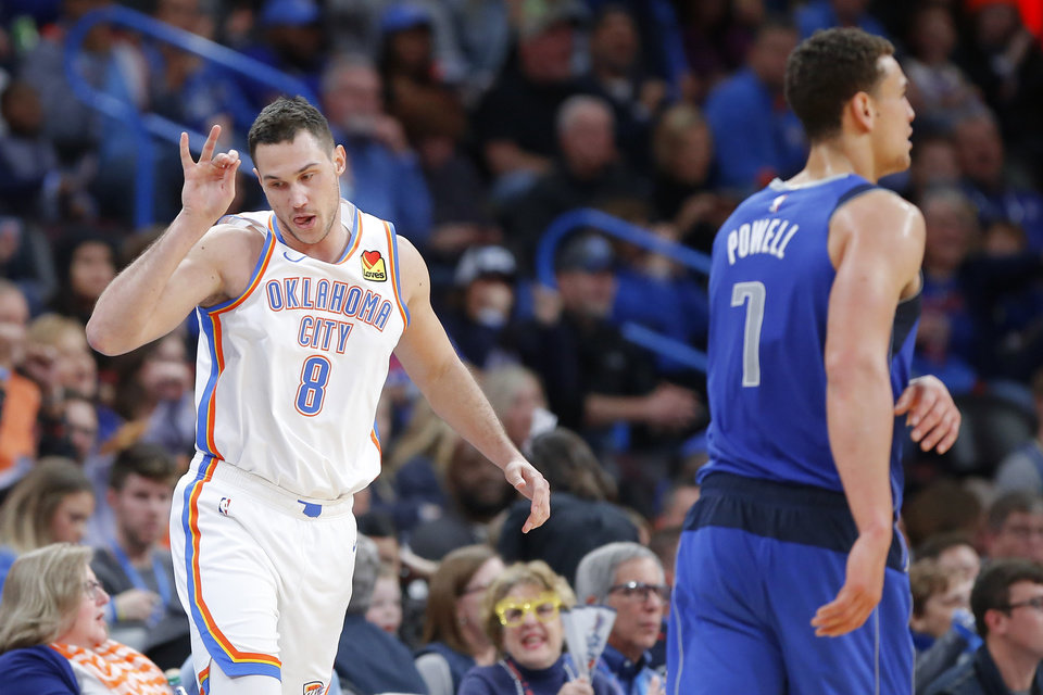 Photo - Oklahoma City's Danilo Gallinari (8) celebrates a basket beside Dwight Powell (7) of Dallas during an NBA basketball game between the Oklahoma City Thunder and the Dallas Mavericks at Chesapeake Energy Arena in Oklahoma City, Tuesday, Dec. 31, 2019. Oklahoma City won 106-101. [Bryan Terry/The Oklahoman]