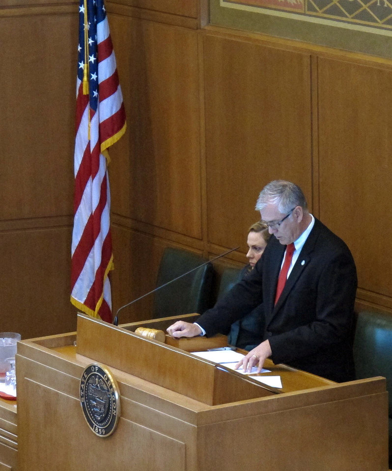 Photo - Oregon House Co-Speaker Bruce Hanna, R-Roseburg, opens a special session Friday, Dec. 14, 2012, in Salem, Ore. The Legislature is considering a tax deal requested by apparel giant Nike Inc., in exchange for bringing hundreds of new jobs. (AP Photo/Jonathan J. Cooper)
